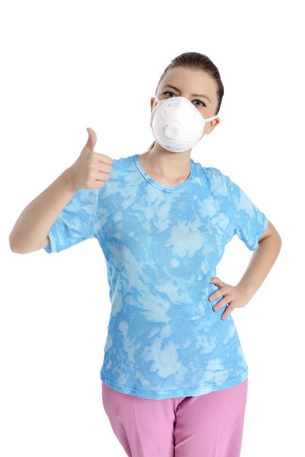 Menina com máscara contra a gripe de suínos fotografia de stock