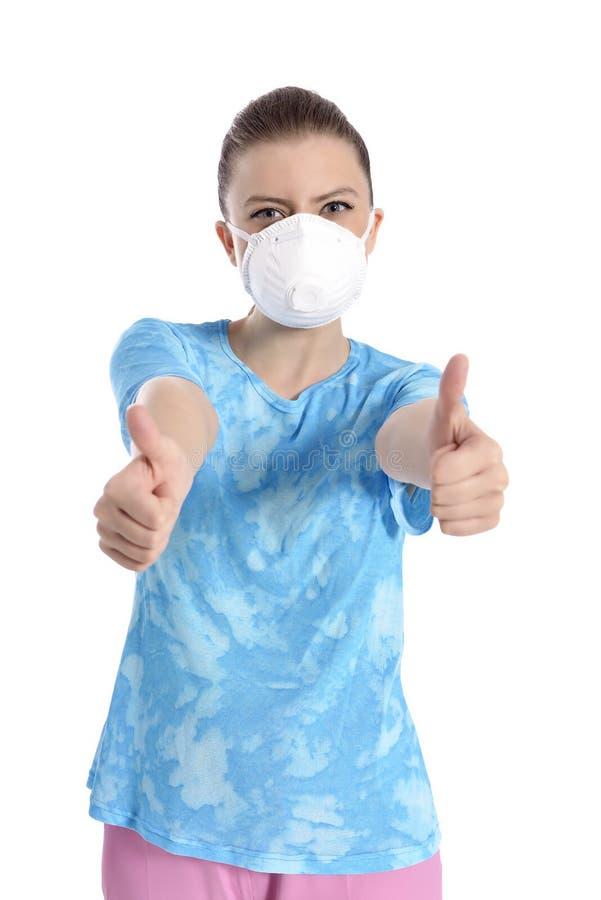 Menina com máscara contra a gripe de suínos foto de stock