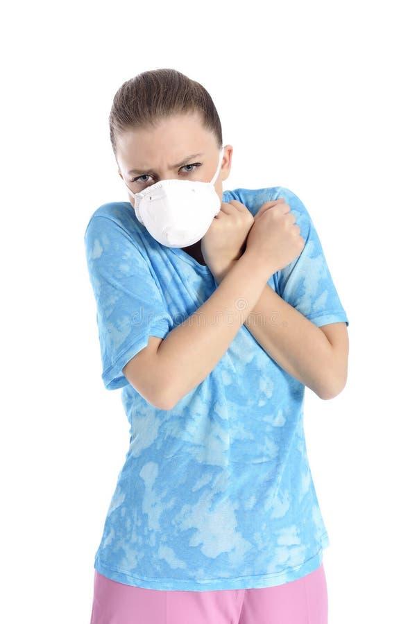Menina com máscara contra a gripe de suínos fotos de stock royalty free