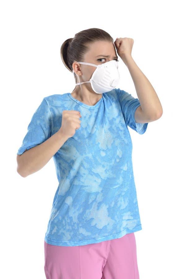 Menina com máscara contra a gripe de suínos fotos de stock