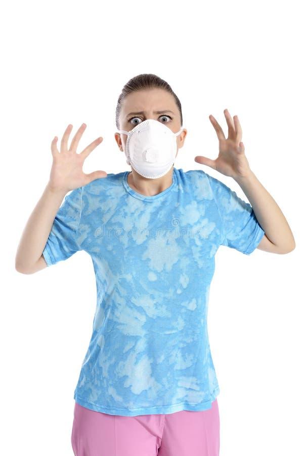 Menina com máscara contra a gripe de suínos fotografia de stock royalty free