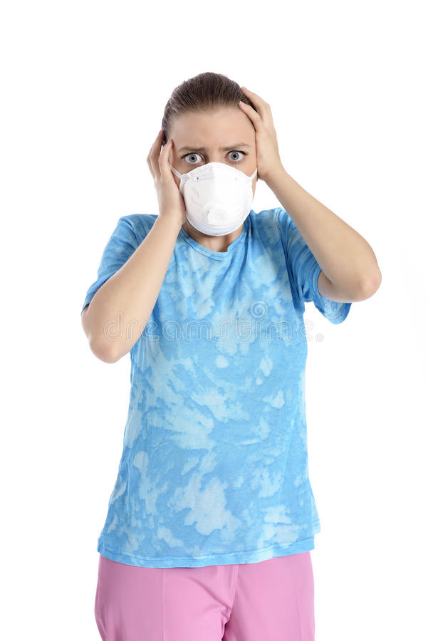 Menina com máscara contra a gripe de suínos imagem de stock royalty free