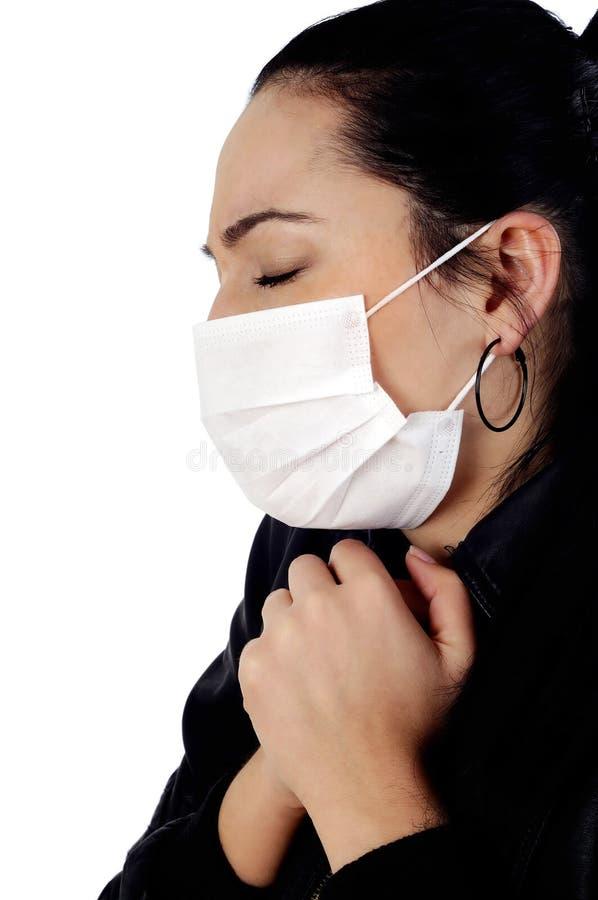 Menina com máscara de encontro à gripe dos suínos foto de stock