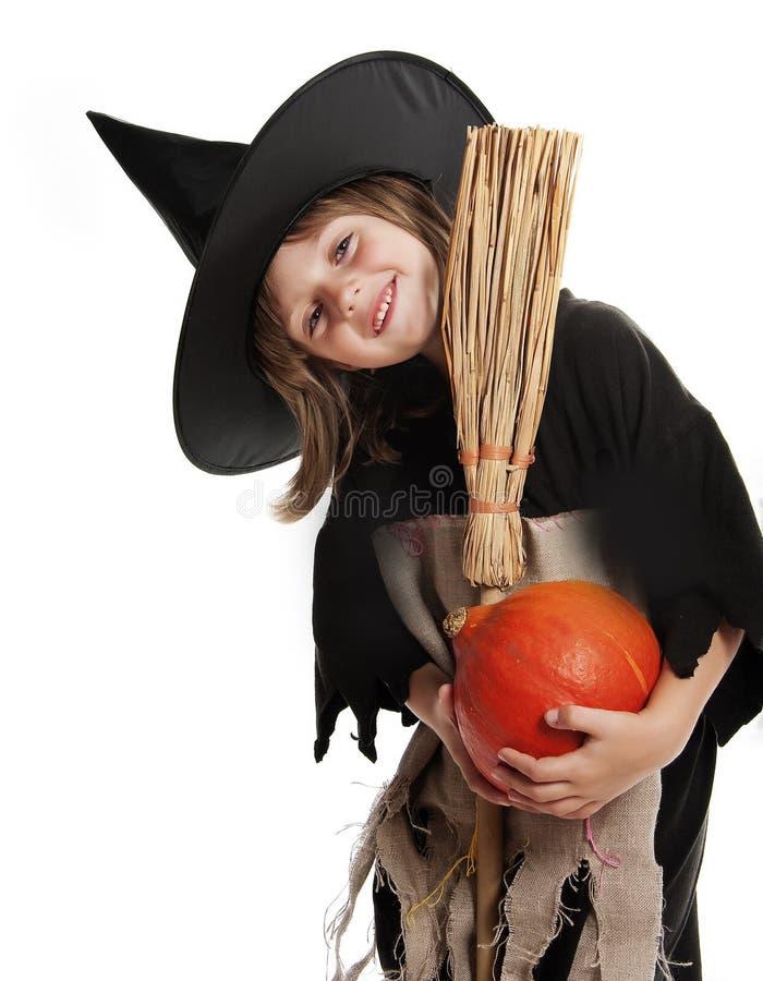 Menina com máscara de Halloween da bruxa imagem de stock royalty free