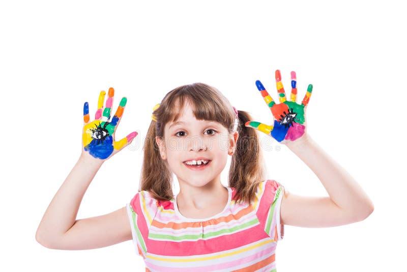 Menina com mãos na pintura foto de stock
