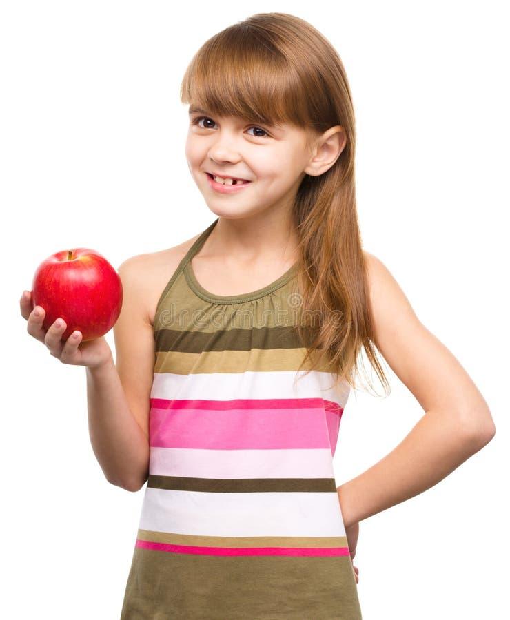 Menina com maçã vermelha fotografia de stock royalty free