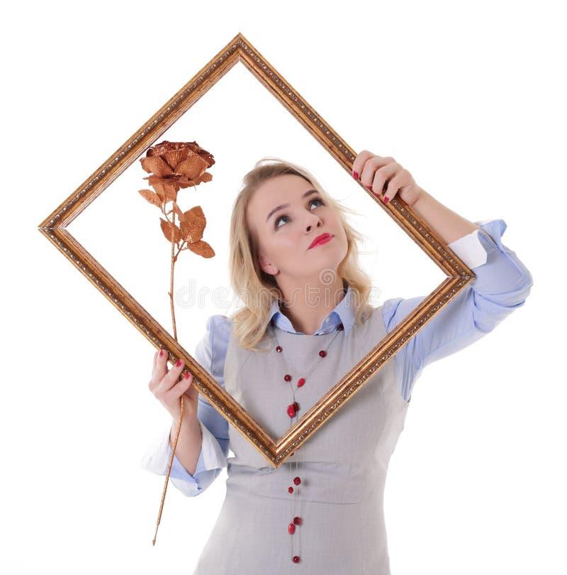 Menina com moldura para retrato fotografia de stock royalty free