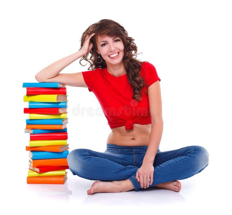 Menina com muitos livros imagem de stock
