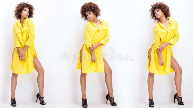 Menina com o afro no vestido amarelo fotos de stock