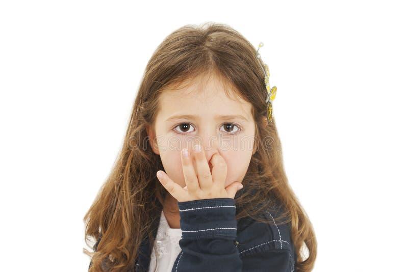 Menina com o dedo em seu nariz foto de stock royalty free