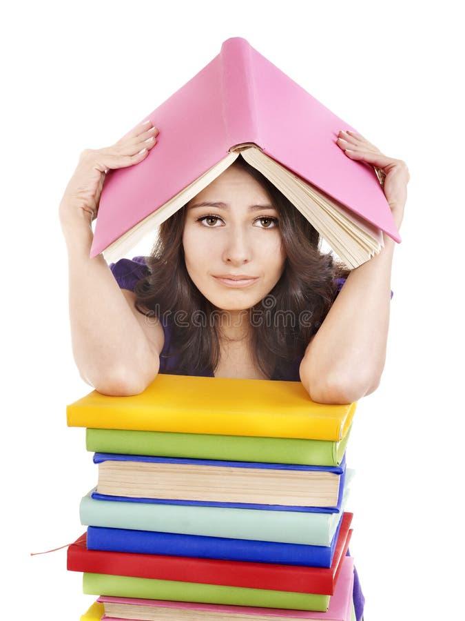Menina com o livro da cor da pilha. fotografia de stock royalty free