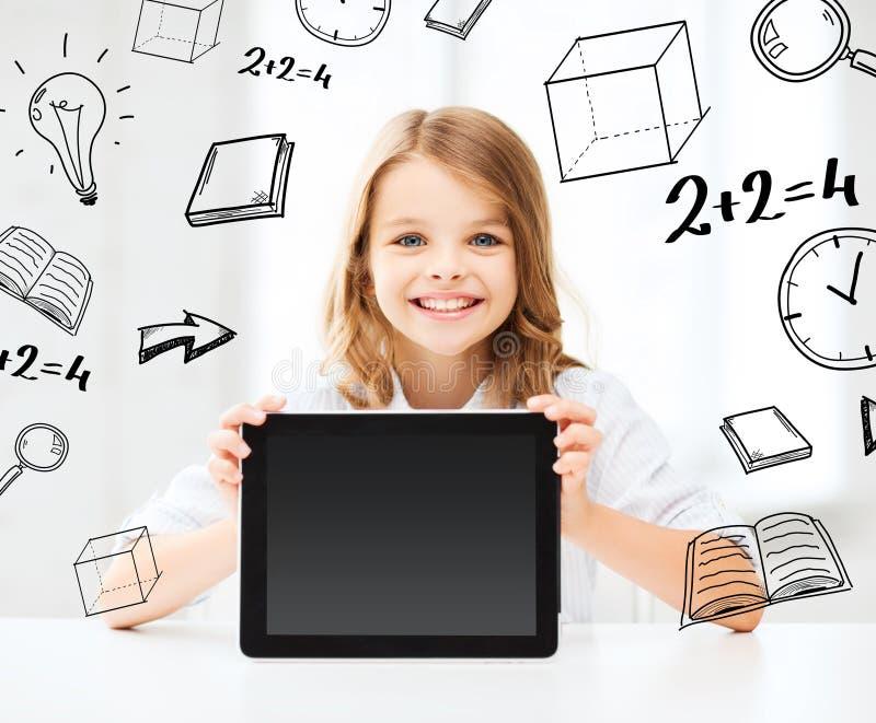 Menina com o PC da tabuleta na escola imagens de stock royalty free
