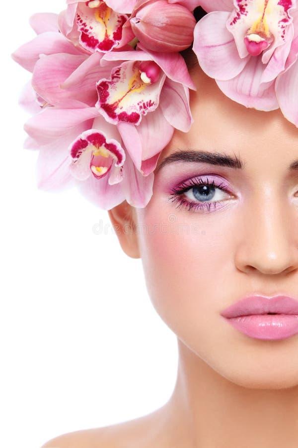 Menina com orquídeas imagem de stock royalty free
