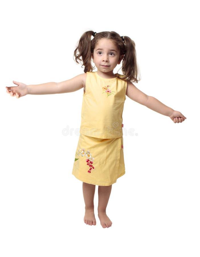Menina com os braços outstretched fotografia de stock