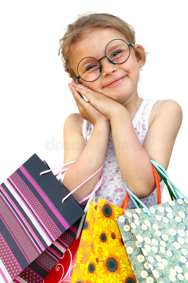 Menina com os sacos de compras no fundo branco foto de stock