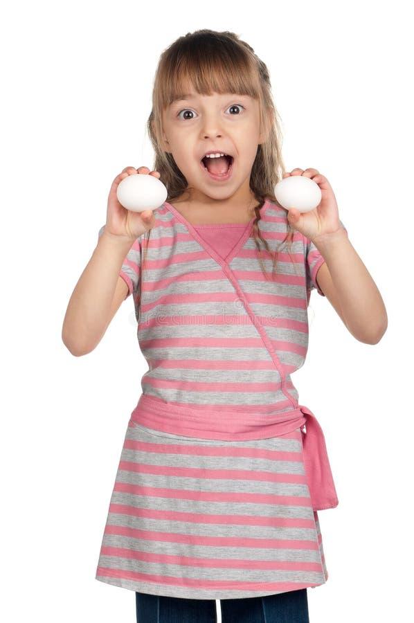Menina com ovos imagens de stock