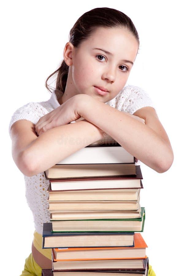 Menina com a pilha de livros imagem de stock