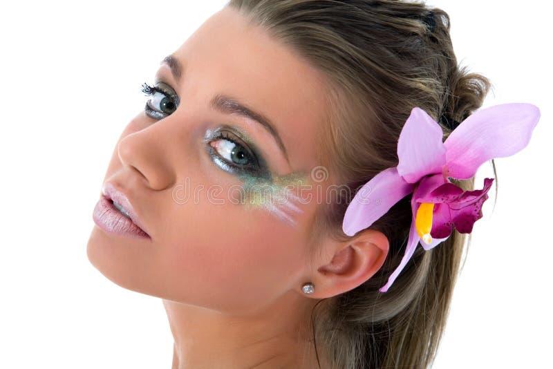 Menina com pintura da borboleta da face-arte imagens de stock royalty free
