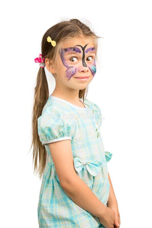 Menina com pintura da cara da borboleta imagens de stock royalty free