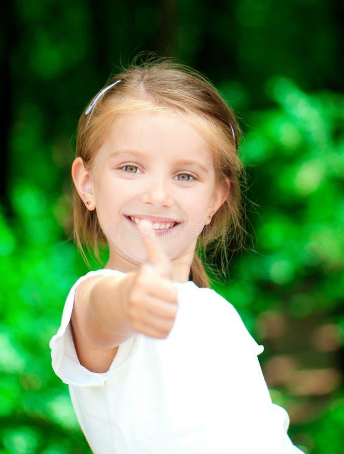Menina com polegar acima fotografia de stock