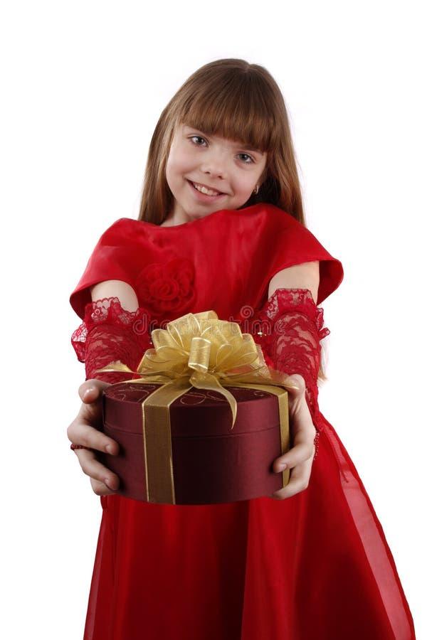 Menina com presente. imagem de stock royalty free