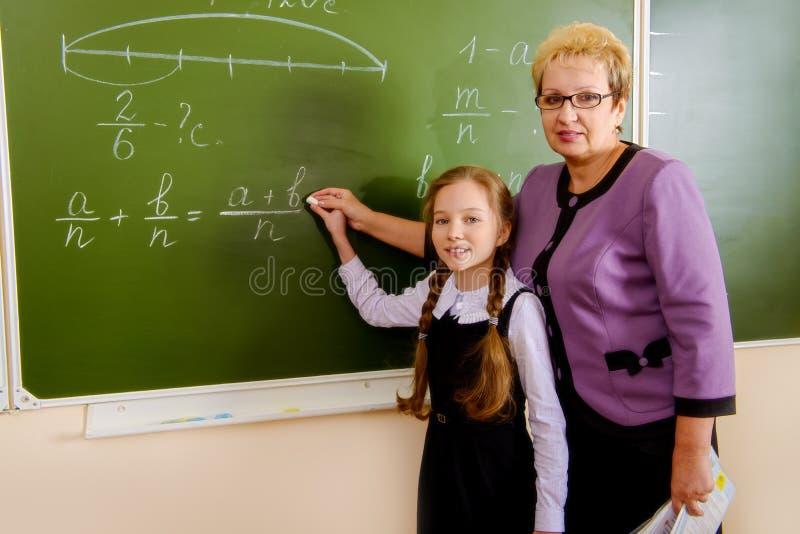 Menina com professor imagens de stock royalty free