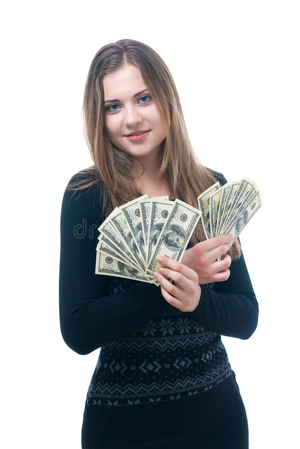 Menina com punhado do dinheiro em suas mãos imagem de stock