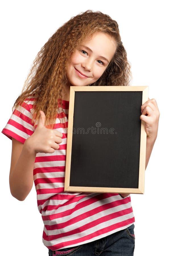 Menina com quadro-negro fotografia de stock royalty free