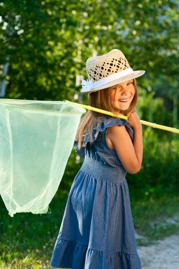 Menina com rede da borboleta. fotografia de stock royalty free