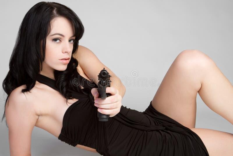 Menina com revólver fotos de stock
