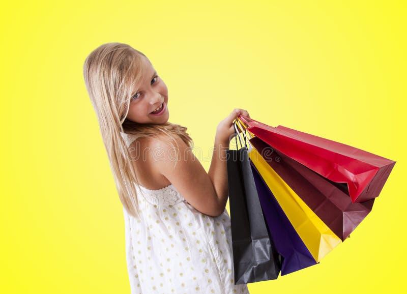 Menina com sacos de compras imagem de stock royalty free