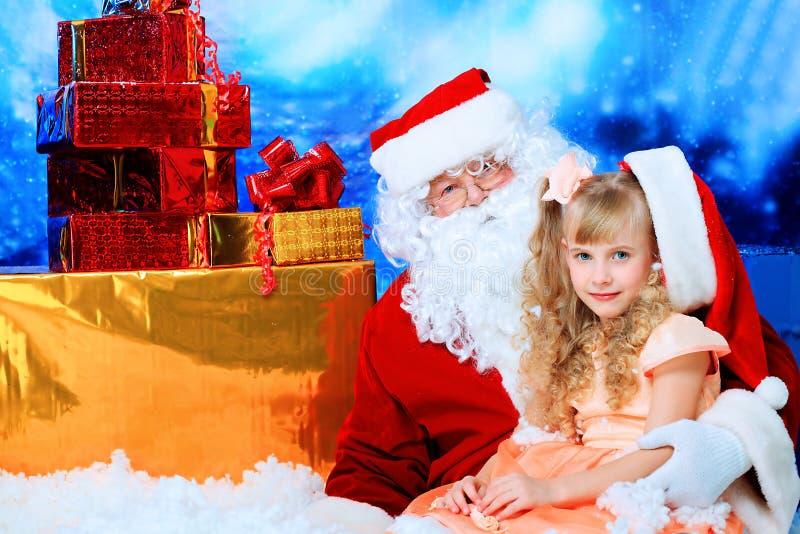 Menina com Santa foto de stock royalty free