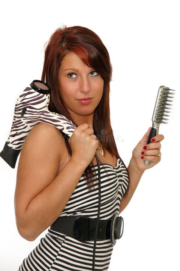 Menina com secador e escova de cabelo imagem de stock royalty free