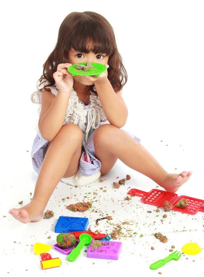 Menina com sua argila imagens de stock