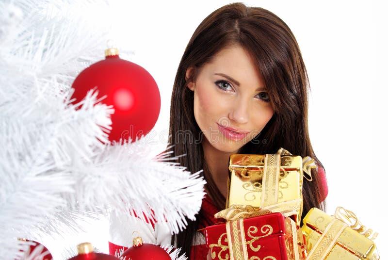 Menina com surpresa do Natal foto de stock