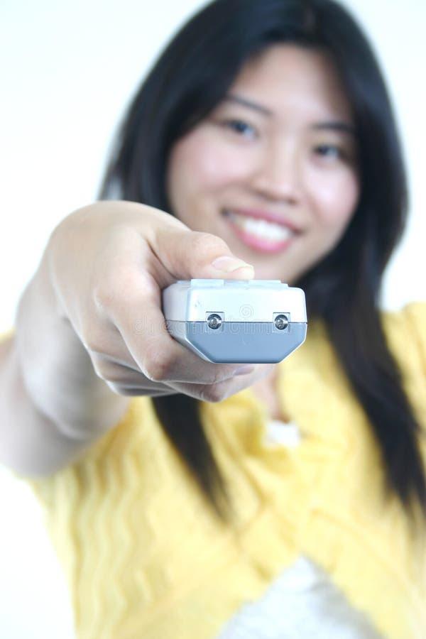 Menina com telecontrole fotografia de stock