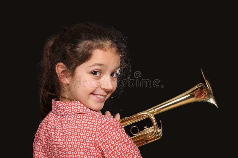 Menina com trombeta imagens de stock royalty free