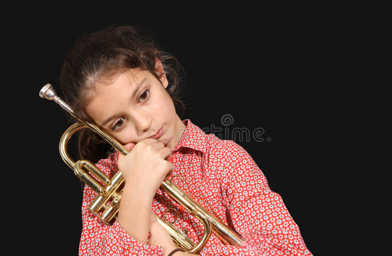 Menina com trombeta fotografia de stock royalty free