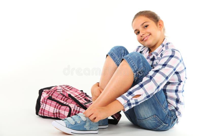 Menina com trouxa fotografia de stock