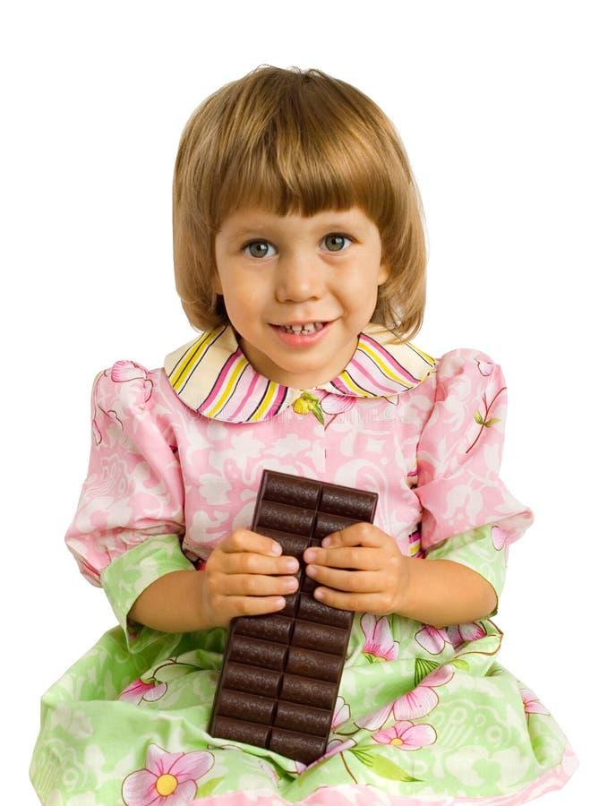 A menina com um chocolate fotos de stock