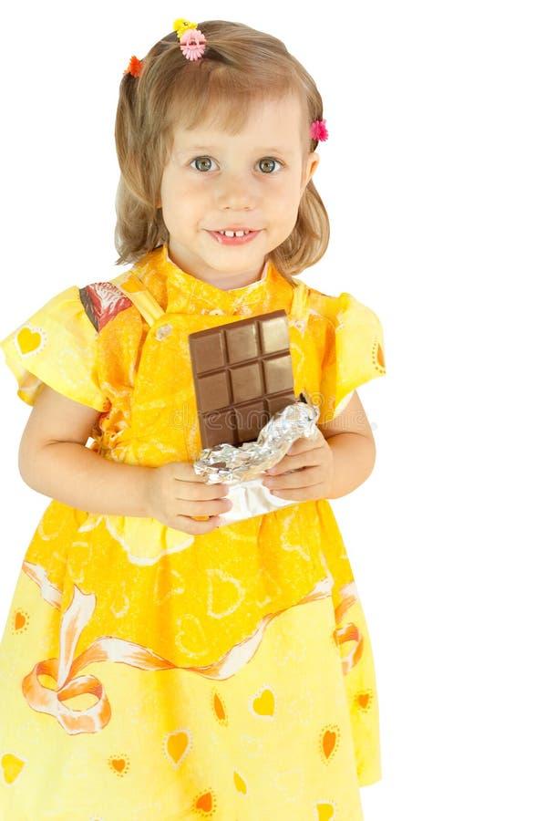 A menina com um chocolate foto de stock royalty free