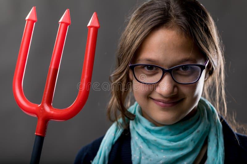 Menina com um forcado grande foto de stock royalty free