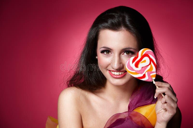 Menina com um lollypop fotos de stock royalty free