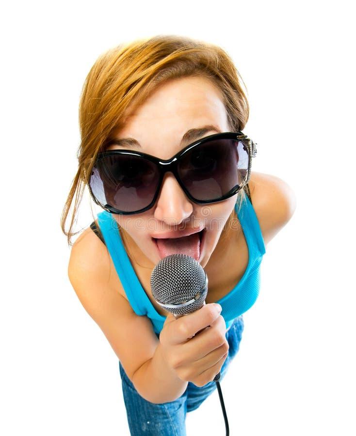 Menina com um microfone imagens de stock
