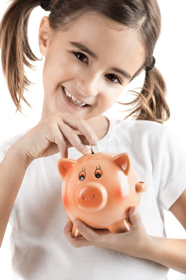 Menina com um piggy-banco foto de stock royalty free