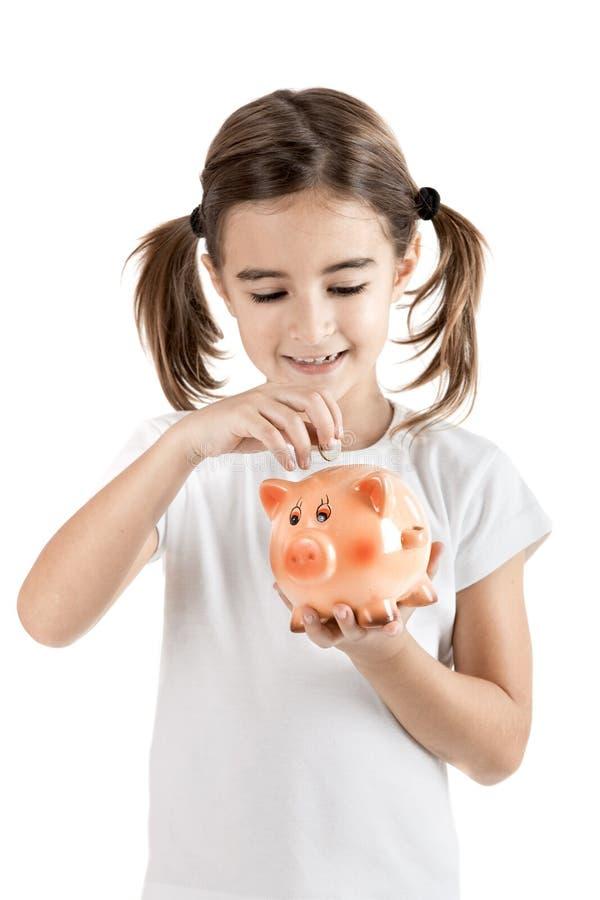 Menina com um piggy-banco foto de stock