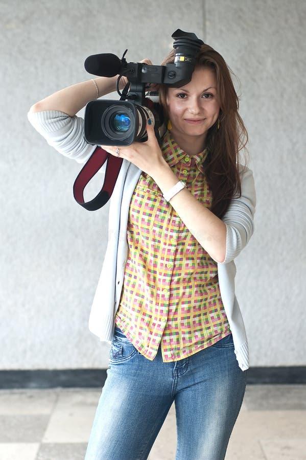 Menina com um vídeo câmera fotografia de stock