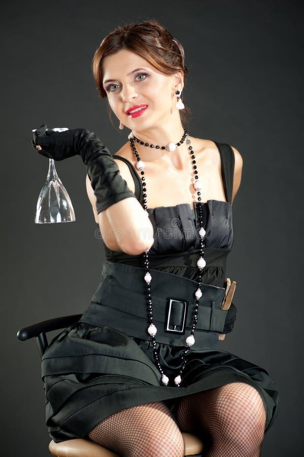 Menina com um vidro imagem de stock royalty free