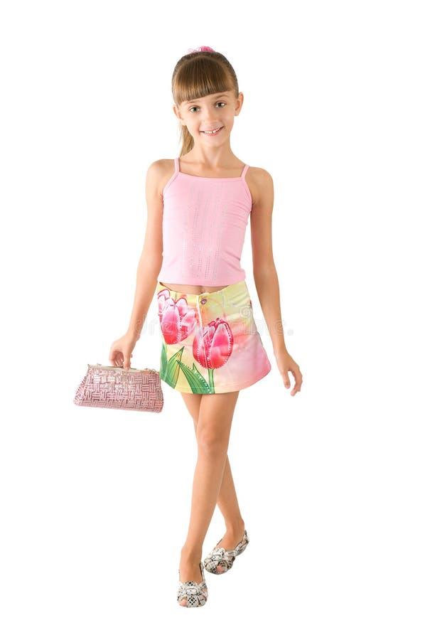 A menina com uma bolsa cor-de-rosa imagens de stock royalty free