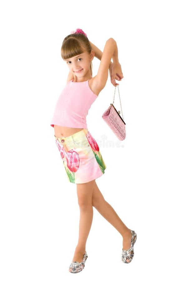 A menina com uma bolsa cor-de-rosa fotografia de stock royalty free